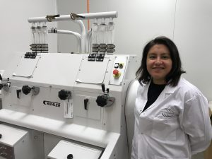 InterGrain's new Wheat Milling Specialist, Fernanda Ham, next to new wheat milling equipment.